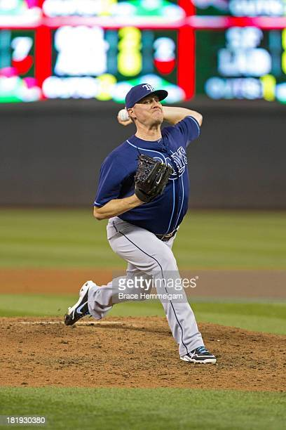 Jake McGee of the Tampa Bay Rays pitches against the Minnesota Twins on September 13 2013 at Target Field in Minneapolis Minnesota The Rays defeated...