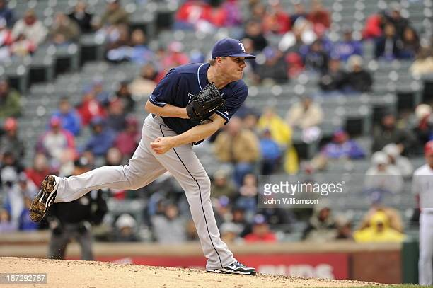 Jake McGee of the Tampa Bay Rays pitches against the Texas Rangers at Rangers Ballpark on April 10 2013 in Arlington Texas The Tampa Bay Rays...