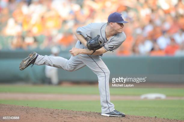 Jake McGee of the Tampa Bay Rays pitches during a baseball game against the Baltimore Orioles on June 28 2014 at Oriole Park at Camden Yards in...