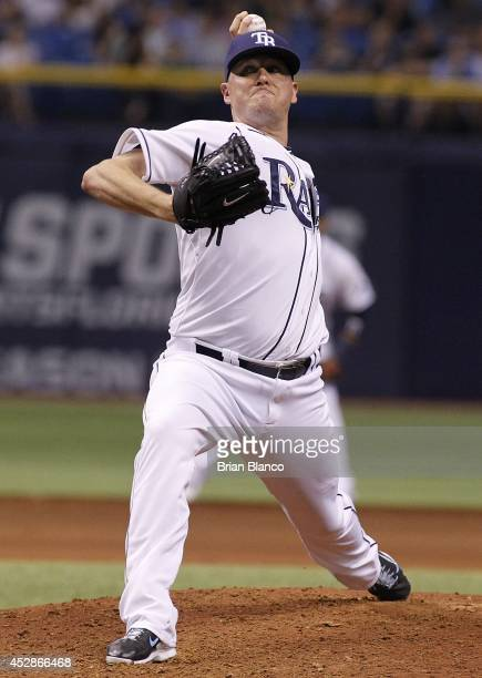 Jake McGee of the Tampa Bay Rays pitches during the ninth inning of a game against the Milwaukee Brewers on July 28 2014 at Tropicana Field in St...