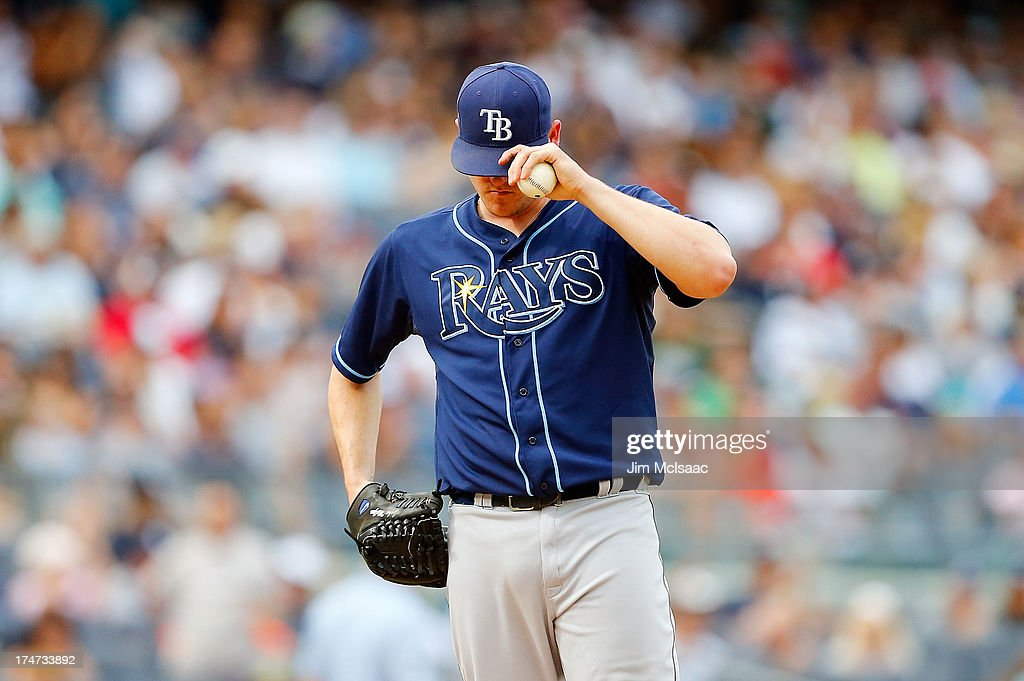 <a gi-track='captionPersonalityLinkClicked' href=/galleries/search?phrase=Jake+McGee+-+Baseball+Player&family=editorial&specificpeople=15096866 ng-click='$event.stopPropagation()'>Jake McGee</a> #57 of the Tampa Bay Rays stands on the mound in the ninth inning against the New York Yankees at Yankee Stadium on July 28, 2013 in the Bronx borough of New York City.