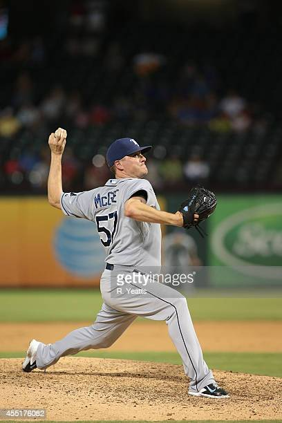 Jake McGee of the Tampa Bay Rays throws i the ninth inning against the Texas Rangers at Globe Life Park in Arlington on August 14 2014 in Arlington...