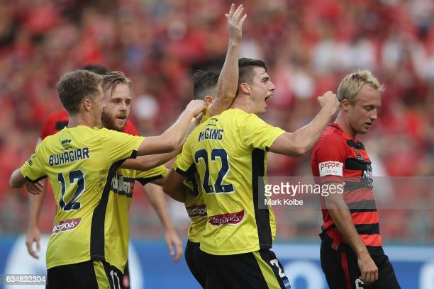 Jake McGing of the Mariners celebrates with Roy O'Donovan of the Mariners after he scored a goal during the round 19 ALeague match between the...