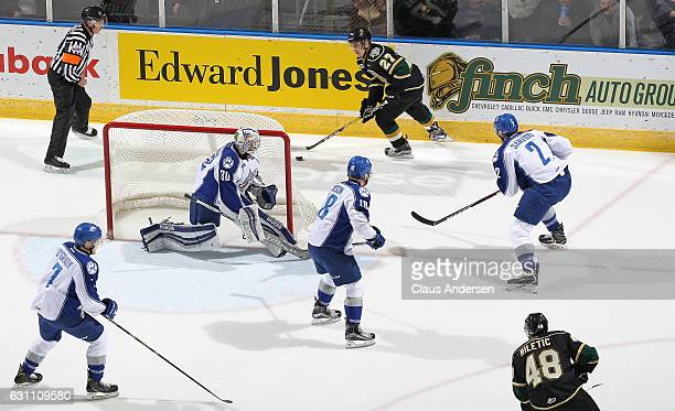 Jake McGrath of the Sudbury Wolves keeps an eye on Robert Thomas of the London Knights during an OHL game at Budweiser Gardens on January 6 2017 in...