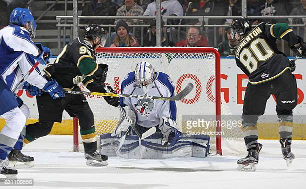Jake McGrath of the Sudbury Wolves stops a shot by Alex Formenton of the London Knights during an OHL game at Budweiser Gardens on January 6 2017 in...