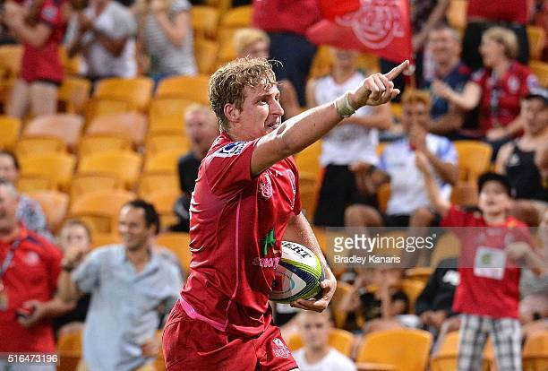 Jake McIntyre of the Reds celebrates scoring a try during the round four Super Rugby match between the Reds and the Blues at Suncorp Stadium on March...