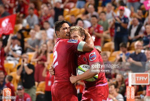 Jake McIntyre of the Reds celebrates with team mate Anthony Fainga'a after scoring a try during the round four Super Rugby match between the Reds and...