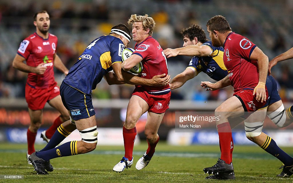 Jake McIntyre of the Reds is tackled during the round 15 Super Rugby match between the Brumbies and the Reds at GIO Stadium on July 1, 2016 in Canberra, Australia.