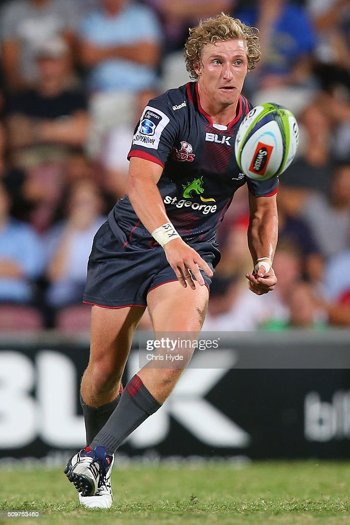 Jake McIntyre of the Reds passes during the Super Rugby Pre-Season match between the Reds and the Brumbies at Ballymore Stadium on February 12, 2016 in Brisbane, Australia.