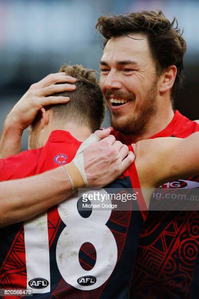 Jake Melksham of the Demons celebrates a goal with Michael Hibberd during the round 18 AFL match between the Melbourne Demons and the Port Adelaide...