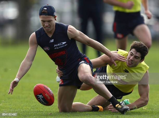 Jake Melksham of the Demons is challenged by Christian Petracca during a Melbourne Demons AFL training session at Gosch's Paddock on August 18 2017...