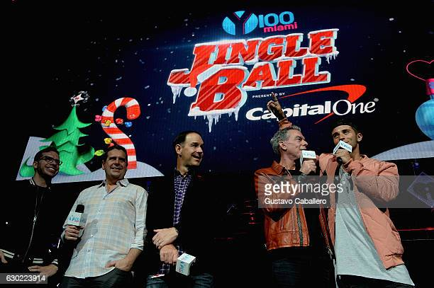 Jake Miller and Radio Host Elvis Duran speak on stage at the Y100's Jingle Ball 2016 at BBT Center on December 18 2016 in Sunrise Florida