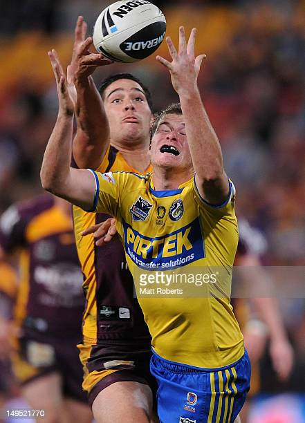 Jake Mullaney of the Eels competes for the ball with Corey Norman of the Broncos during the round 21 NRL match between the Brisbane Broncos and the...
