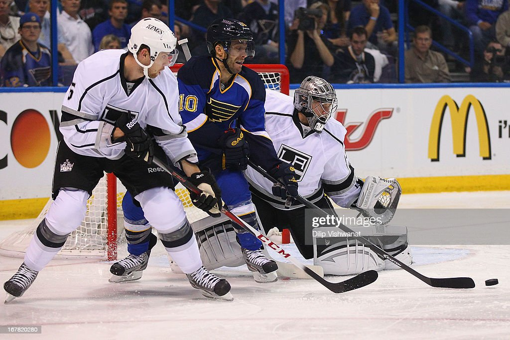 Jake Muzzin #6 and Jonathan Quick #32 both of the Los Angeles Kings defend the net against Andy McDonald #10 of the St. Louis Blues in Game One of the Western Conference Quarterfinals during the 2013 NHL Stanley Cup Playoffs at the Scottrade Center on April 30, 2013 in St. Louis, Missouri.