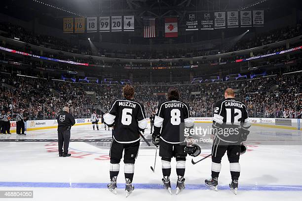 Jake Muzzin Drew Doughty and Marian Gaborik of the Los Angeles Kings stand in observance of the national anthem before a game against the Colorado...