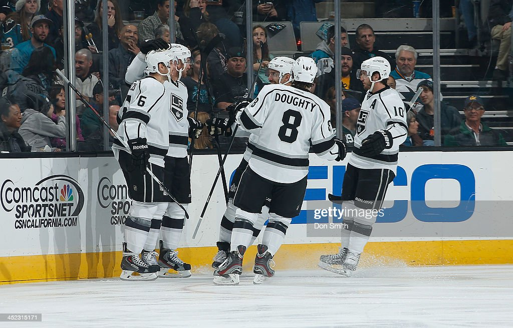 <a gi-track='captionPersonalityLinkClicked' href=/galleries/search?phrase=Jake+Muzzin&family=editorial&specificpeople=7205557 ng-click='$event.stopPropagation()'>Jake Muzzin</a> #6, <a gi-track='captionPersonalityLinkClicked' href=/galleries/search?phrase=Drew+Doughty&family=editorial&specificpeople=2085761 ng-click='$event.stopPropagation()'>Drew Doughty</a> #8, Mike Richards #10, <a gi-track='captionPersonalityLinkClicked' href=/galleries/search?phrase=Jeff+Carter&family=editorial&specificpeople=227320 ng-click='$event.stopPropagation()'>Jeff Carter</a> #77 and <a gi-track='captionPersonalityLinkClicked' href=/galleries/search?phrase=Dwight+King+-+Ice+Hockey+Player&family=editorial&specificpeople=4537297 ng-click='$event.stopPropagation()'>Dwight King</a> #74 of the Los Angeles Kings celebrate after <a gi-track='captionPersonalityLinkClicked' href=/galleries/search?phrase=Jeff+Carter&family=editorial&specificpeople=227320 ng-click='$event.stopPropagation()'>Jeff Carter</a>'s goal against the San Jose Sharks during an NHL game on November 27, 2013 at SAP Center in San Jose, California.