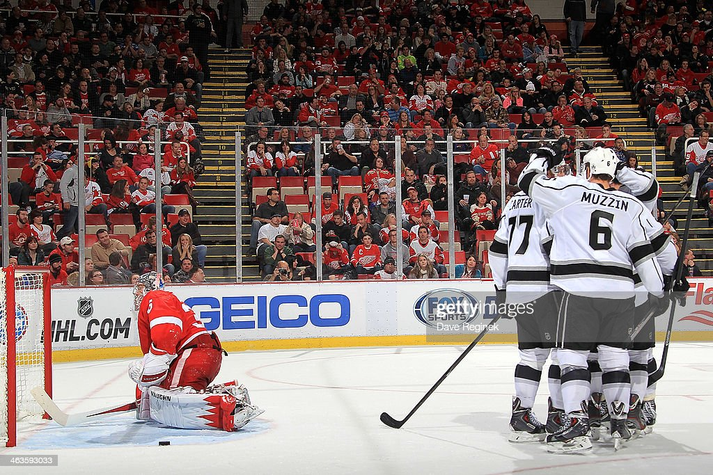 <a gi-track='captionPersonalityLinkClicked' href=/galleries/search?phrase=Jake+Muzzin&family=editorial&specificpeople=7205557 ng-click='$event.stopPropagation()'>Jake Muzzin</a> #6, Mike Richards #10 and <a gi-track='captionPersonalityLinkClicked' href=/galleries/search?phrase=Anze+Kopitar&family=editorial&specificpeople=634911 ng-click='$event.stopPropagation()'>Anze Kopitar</a> #11 of the Los Angeles Kings congratulate teammate <a gi-track='captionPersonalityLinkClicked' href=/galleries/search?phrase=Jeff+Carter&family=editorial&specificpeople=227320 ng-click='$event.stopPropagation()'>Jeff Carter</a> #77 after scoring a goal while <a gi-track='captionPersonalityLinkClicked' href=/galleries/search?phrase=Jimmy+Howard&family=editorial&specificpeople=2118637 ng-click='$event.stopPropagation()'>Jimmy Howard</a> #35 of the Detroit Red Wings gets up as the puck sits in the crease during an NHL game on January 18, 2014 at Joe Louis Arena in Detroit, Michigan. The Red Wings defeated the Kings 3-2 in a shootout