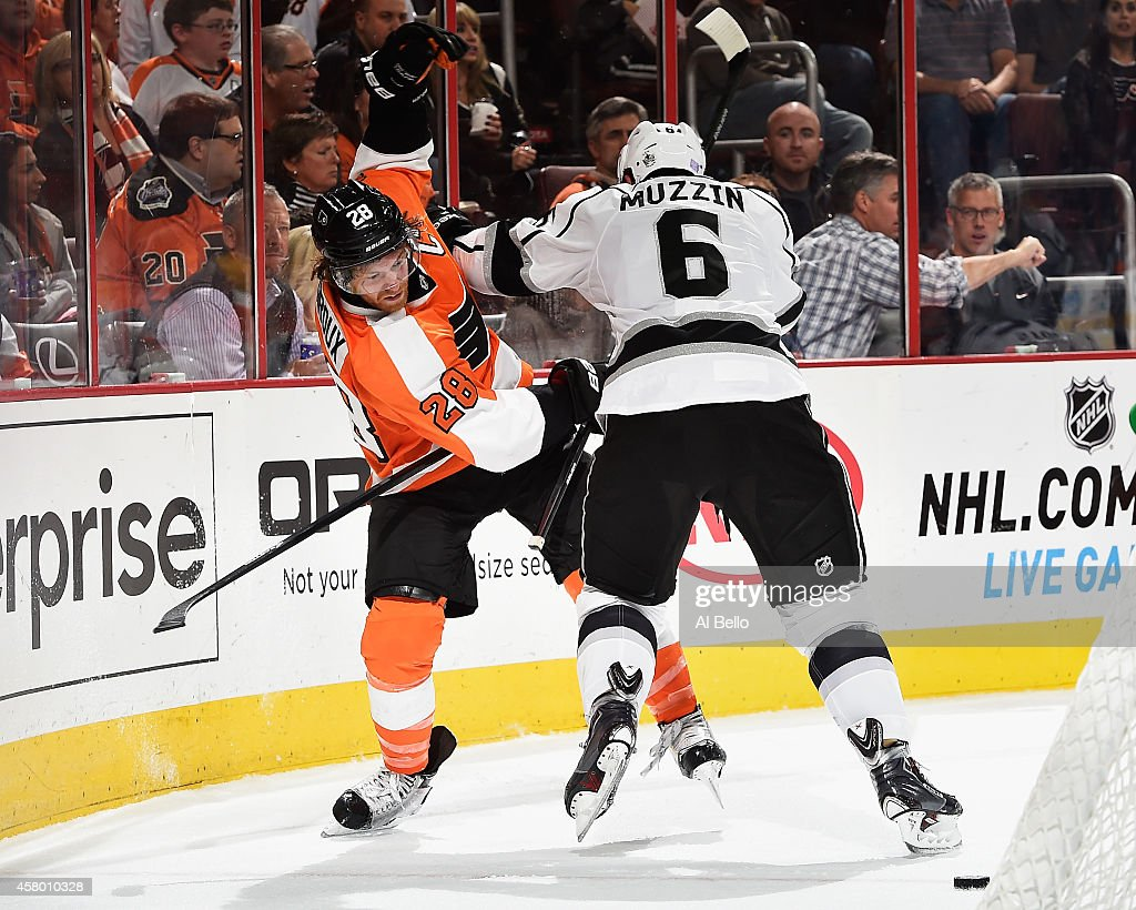 Jake Muzzin #6 of the Los Angeles Kings and Claude Giroux #28 of the Philadelphia Flyers battle for the puck during their game at the Wells Fargo Center on October 28, 2014 in Philadelphia, Pennsylvania.