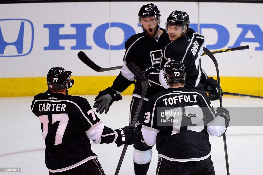 <a gi-track='captionPersonalityLinkClicked' href=/galleries/search?phrase=Jake+Muzzin&family=editorial&specificpeople=7205557 ng-click='$event.stopPropagation()'>Jake Muzzin</a> #6 of the Los Angeles Kings and Dustin Brown #23 celebrate Muzzin's first period goal against the Chicago Blackhawks in Game Four of the Western Conference Final during the 2014 Stanley Cup Playoffs at Staples Center on May 26, 2014 in Los Angeles, California.
