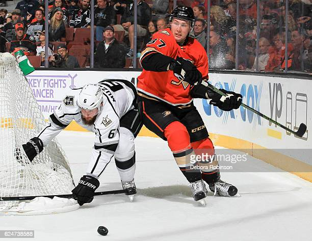 Jake Muzzin of the Los Angeles Kings and Nick Ritchie of the Anaheim Ducks race for the puck during the game at Honda Center on November 20 2016 in...