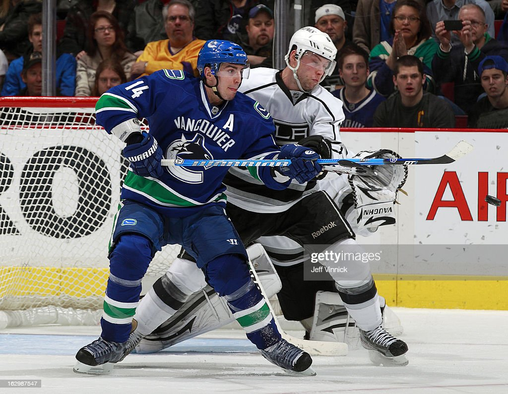 Jake Muzzin #6 of the Los Angeles Kings attempts to move <a gi-track='captionPersonalityLinkClicked' href=/galleries/search?phrase=Alexandre+Burrows&family=editorial&specificpeople=592489 ng-click='$event.stopPropagation()'>Alexandre Burrows</a> #14 of the Vancouver Canucks as the puck approaches during their NHL game at Rogers Arena March 2, 2013 in Vancouver, British Columbia, Canada. Vancouver won 5-2.