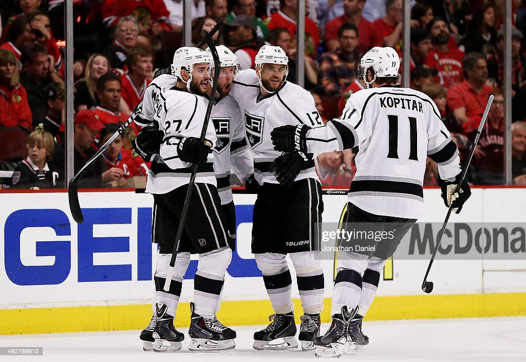 <a gi-track='captionPersonalityLinkClicked' href=/galleries/search?phrase=Jake+Muzzin&family=editorial&specificpeople=7205557 ng-click='$event.stopPropagation()'>Jake Muzzin</a> #6 of the Los Angeles Kings celebrates his goal with teammates in the third period against the Chicago Blackhawks in Game Two of the Western Conference Final during the 2014 Stanley Cup Playoffs at United Center on May 21, 2014 in Chicago, Illinois.