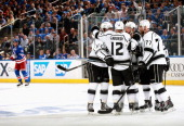 Jake Muzzin of the Los Angeles Kings celebrates with his linemates Marian Gaborik and Jeff Carter after scoring against the New York Rangers during...