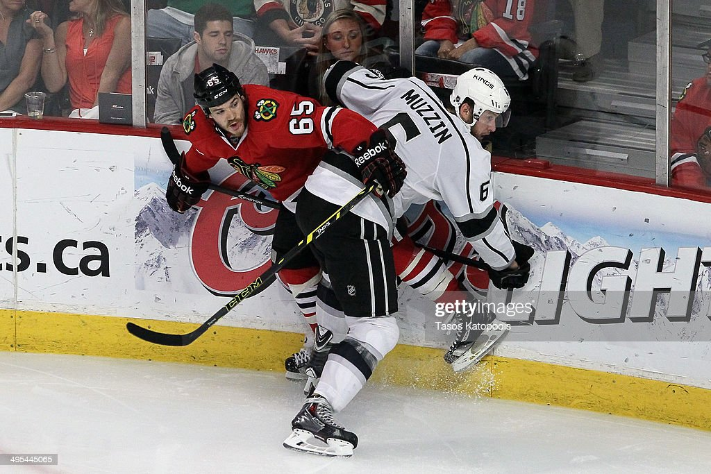 Jake Muzzin #6 of the Los Angeles Kings checks Andrew Shaw #65 of the Chicago Blackhawks during Game Seven of the Western Conference Final in the 2014 Stanley Cup Playoffs at United Center on June 1, 2014 in Chicago, Illinois.