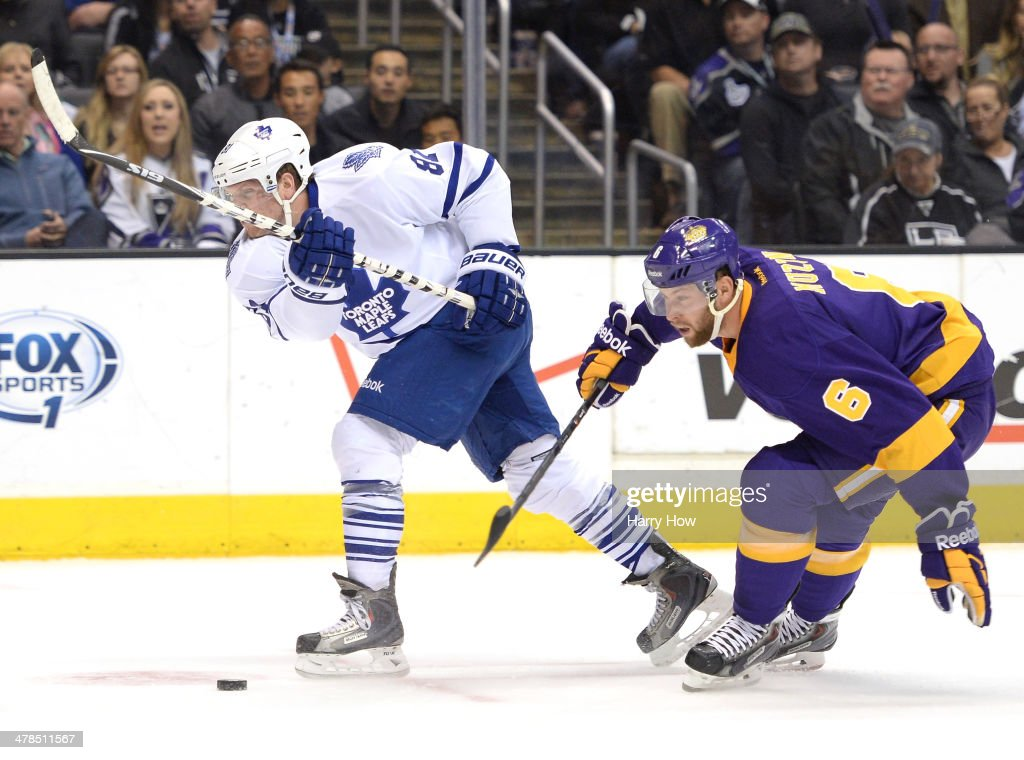 Jake Muzzin #6 of the Los Angeles Kings is called for a hooking penalty on Phil Kessel #81 of the Toronto Maple Leafs during the first period at Staples Center on March 13, 2014 in Los Angeles, California.