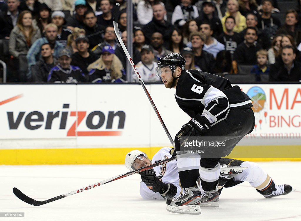 Jake Muzzin #6 of the Los Angeles Kings knocks down Teemu Selanne #8 of the Anaheim Ducks after his shot during a 5-2 Kings win at Staples Center on February 25, 2013 in Los Angeles, California.