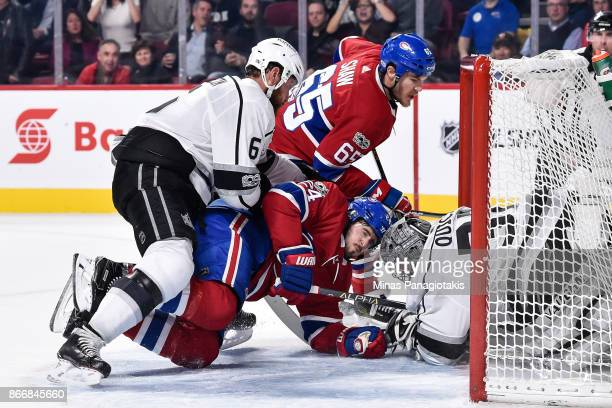 Jake Muzzin of the Los Angeles Kings pushes Phillip Danault of the Montreal Canadiens into goaltender Jonathan Quick during the NHL game at the Bell...