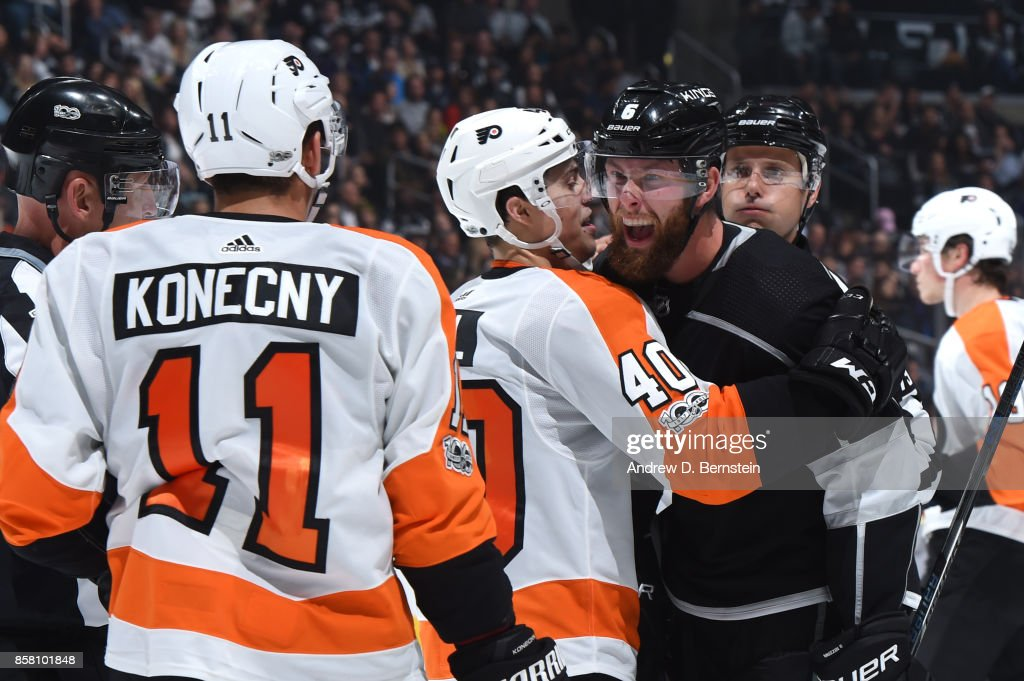 Jake Muzzin #6 of the Los Angeles Kings reacts against Jordan Weal #40 and Travis Konecny #11 of the Philadelphia Flyers at STAPLES Center on October 05, 2017 in Los Angeles, California.