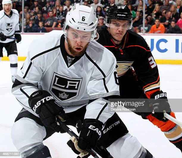 Jake Muzzin of the Los Angeles Kings skates against Jakob Silfverberg of the Anaheim Ducks on March 18 2015 at Honda Center in Anaheim California