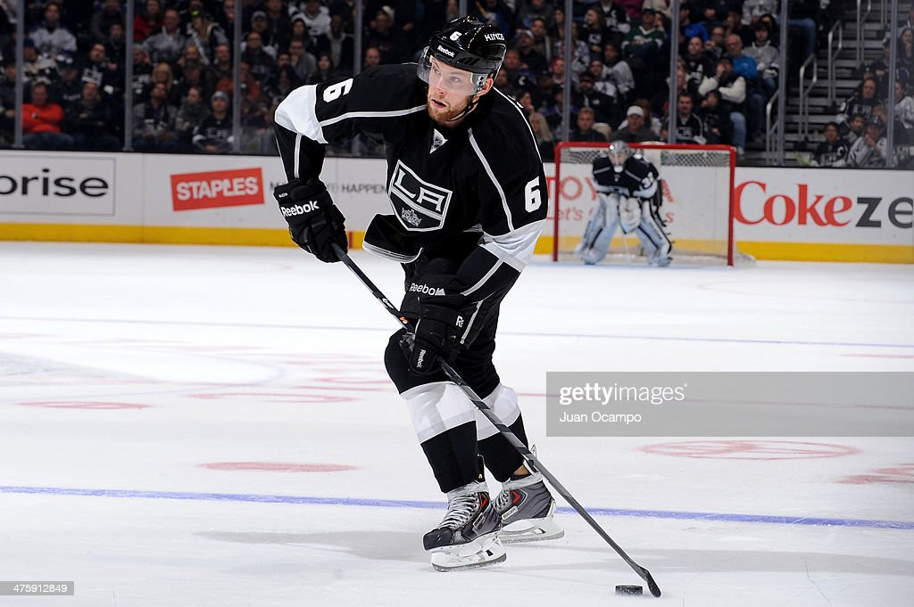 <a gi-track='captionPersonalityLinkClicked' href=/galleries/search?phrase=Jake+Muzzin&family=editorial&specificpeople=7205557 ng-click='$event.stopPropagation()'>Jake Muzzin</a> #6 of the Los Angeles Kings skates with the puck against the Carolina Hurricanes at Staples Center on March 1, 2014 in Los Angeles, California.