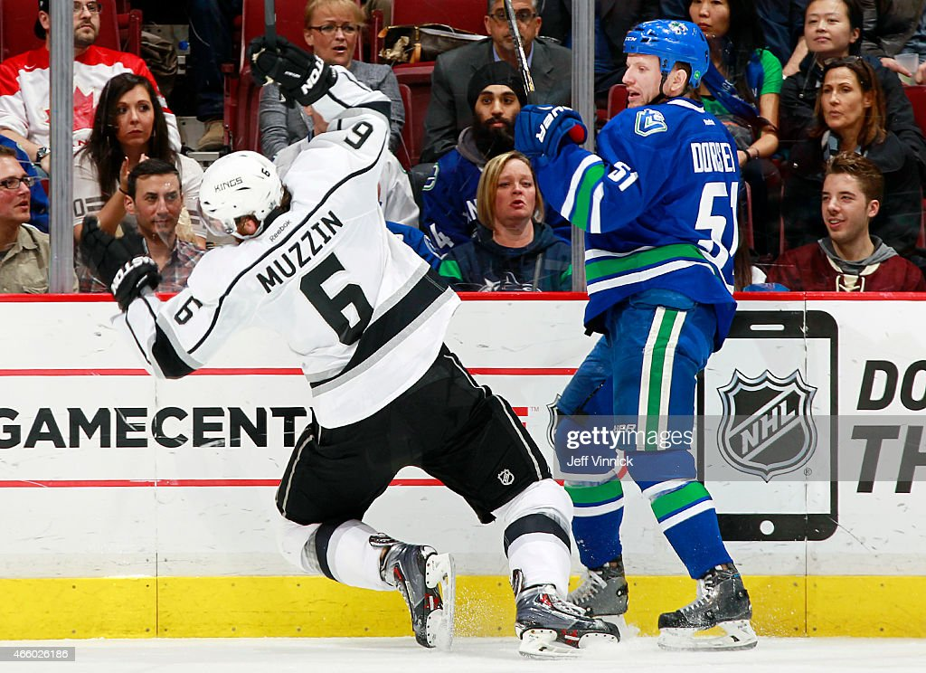 <a gi-track='captionPersonalityLinkClicked' href=/galleries/search?phrase=Jake+Muzzin&family=editorial&specificpeople=7205557 ng-click='$event.stopPropagation()'>Jake Muzzin</a> #6 of the Los Angeles Kings stumbles after colliding with <a gi-track='captionPersonalityLinkClicked' href=/galleries/search?phrase=Derek+Dorsett&family=editorial&specificpeople=4306277 ng-click='$event.stopPropagation()'>Derek Dorsett</a> #51 of the Vancouver Canucks during their NHL game at Rogers Arena March 12, 2015 in Vancouver, British Columbia, Canada.
