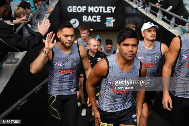Jake Neade and Jarman Impey of the Power walk onto the ground during a Port Adelaide Power AFL training session at Adelaide Oval on September 8 2017...