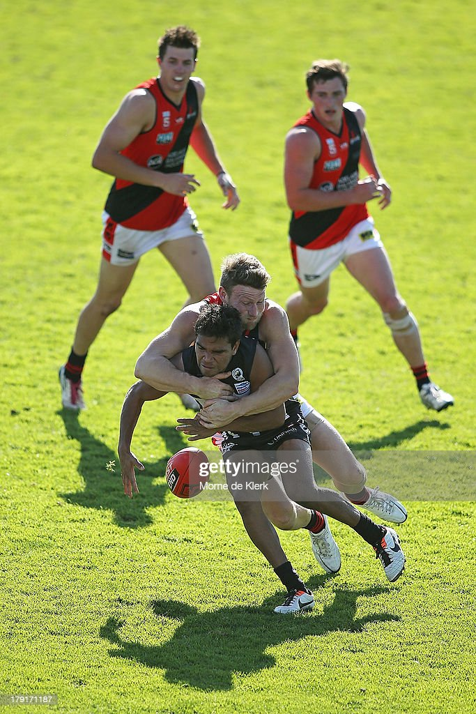 Jake Neade of the Magpies is tackled during the round 22 SANFL match between the Port Adelaide Magpies and the West Adelaide Bloods at Alberton Oval on September 1, 2013 in Adelaide, Australia.