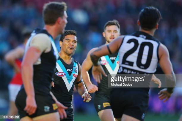 Jake Neade of the Power celebrates a goal by Chad Wingard of the Power during the round 13 AFL match between the Port Adelaide Power and the Brisbane...