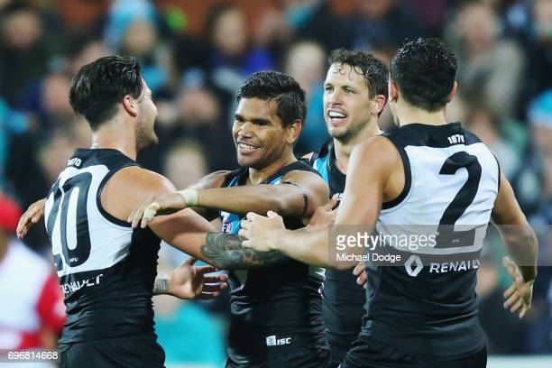 Jake Neade of the Power celebrates a goal during the round 13 AFL match between the Port Adelaide Power and the Brisbane Lions at Adelaide Oval on...