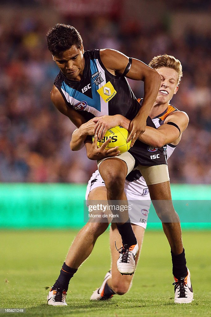 Jake Neade of the Power is tackled during the round two AFL match between Port Adelaide Power and the Greater Western Sydney Giants at AAMI Stadium on April 6, 2013 in Adelaide, Australia.
