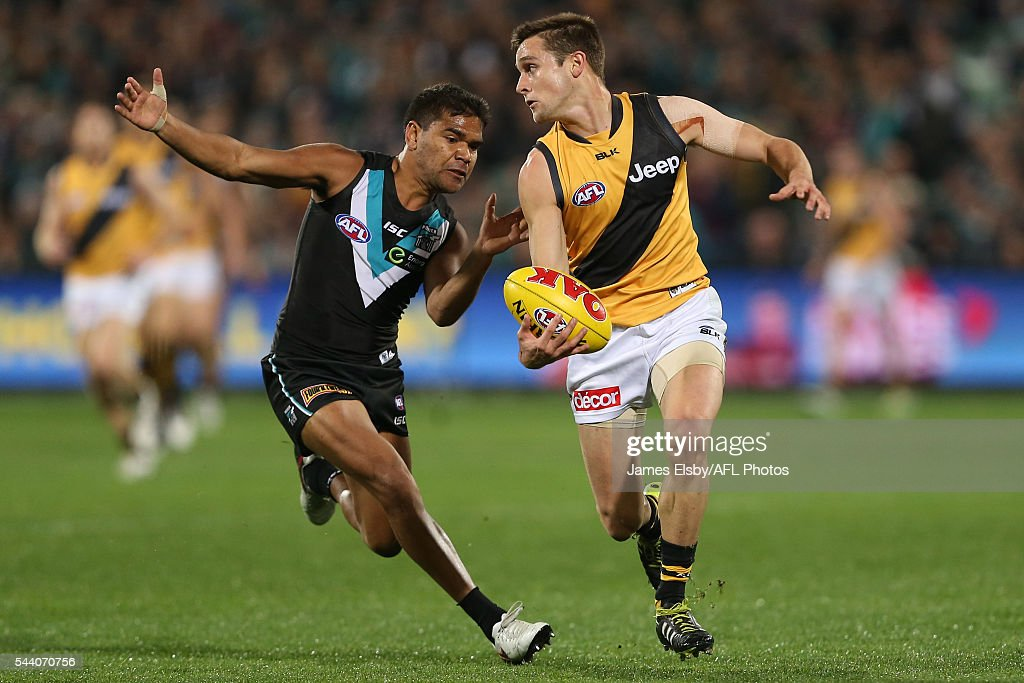 Jake Neade of the Power tackles Jayden Short of the Tigers during the 2016 AFL Round 15 match between Port Adelaide Power and the Richmond Tigers at Adelaide Oval on July 1, 2016 in Adelaide, Australia.