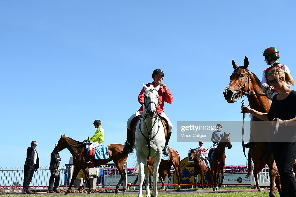 Jake Noonan riding Return Journey (R) after winning the Maxie Howell Handicap at Caulfield Racecourse on December 26, 2012 in Melbourne, Australia.