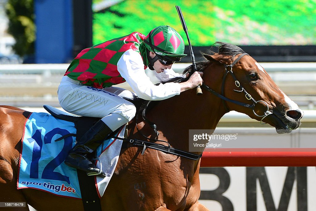 Jake Noonan riding Return Journey wins the Maxie Howell Handicap at Caulfield Racecourse on December 26, 2012 in Melbourne, Australia.
