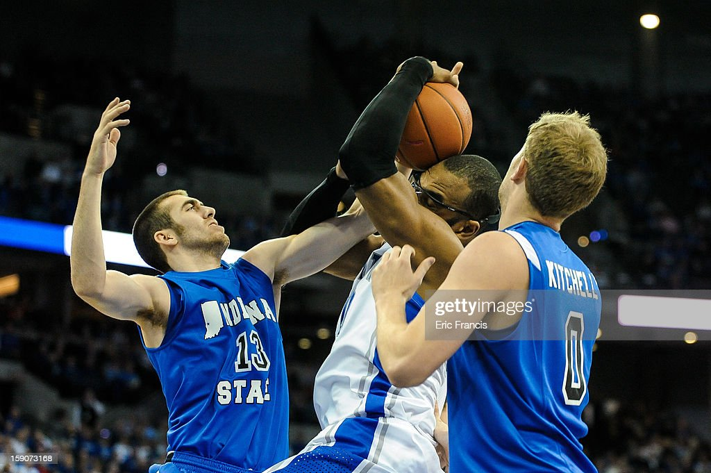 Jake Odum #13 of the Indiana State Sycamores fights for a rebound with <a gi-track='captionPersonalityLinkClicked' href=/galleries/search?phrase=Gregory+Echenique&family=editorial&specificpeople=5648736 ng-click='$event.stopPropagation()'>Gregory Echenique</a> #00 of the Creighton Bluejays during their game at the CenturyLink Center on January 5, 2013 in Omaha, Nebraska. Creighton defeated Evansville 87-70.