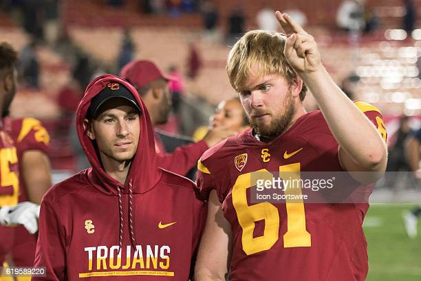 Jake Olson listens to the band after an NCAA football game between the California Golden Bears and the USC Trojans on October 27 at the Los Angeles...