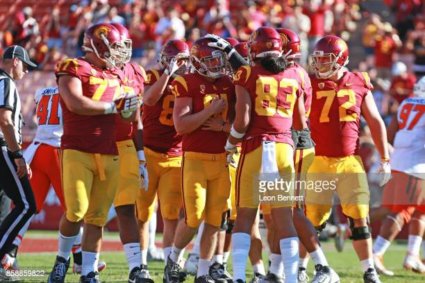 Jake Olson of the USC Trojans celebrates with his team mates after hiking the ball in a 3810 win against the Oregon State Beavers at Los Angeles...