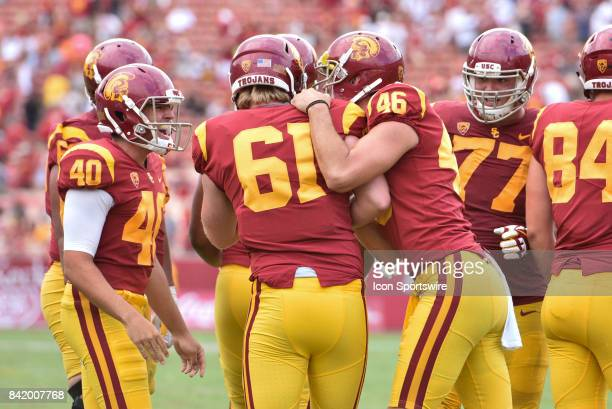 Jake Olson who is blind gets congratulated by his teammates after snapping the ball for an extra point for the first time in a NCAA Football game...