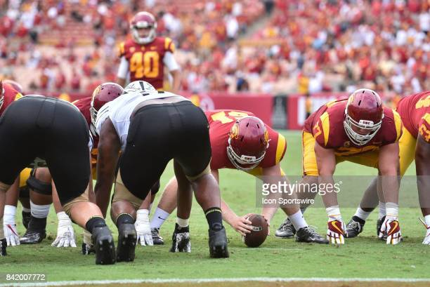 Jake Olson who is blind gets ready to snap the ball for an extra point in the fourth quarter for the first time in a NCAA Football game between the...