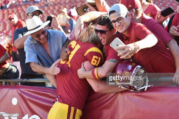 Jake Olson who is blind jumps into the crowd after a college football game between the Oregon State Beavers and the USC Trojans on October 7 at Los...