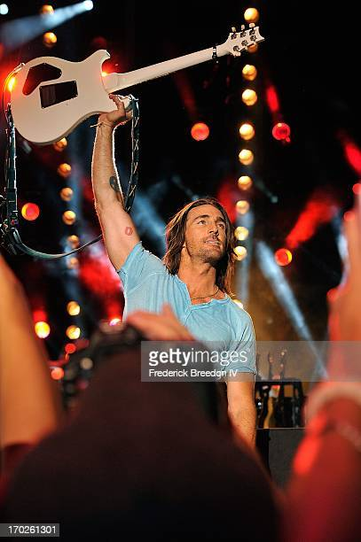 Jake Owen salutes the fans from the crowd after a performance at LP Field during the 2013 CMA Music Festival on June 9 2013 in Nashville Tennessee